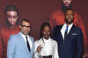 """Jordan Peele, Lupita Nyong'o and Winston Duke attend the """"US"""" premiere at Museum of Modern Art on March 19, 2019 in New York City."""