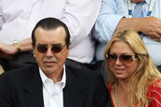 Chazz Palminteri (top L), wife Gianna (top R), and Alec Baldwin (bottom) watch the men's semi-final  during day fourteen of the 2009 U.S. Open at the USTA Billie Jean King National Tennis Center on September 13, 2009 in the Flushing neighborhood of the Queens borough of New York City.