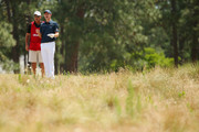 Justin Rose of England talks with caddie Mark Fulcher on the fifth hole during the first round of the 114th U.S. Open at Pinehurst Resort & Country Club, Course No. 2 on June 12, 2014 in Pinehurst, North Carolina.