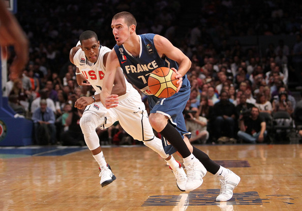 Nando De Colo #12 of France dribbles past Rajon Rondo #7 of the United States during their exhibition game as part of the World Basketball Festival at Madison Square Garden on August 15, 2010 in New York City.
