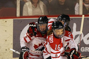 Gina Kingsbury #27 of Canada celebrates her first period goal with Jayna Hefford #16 and Tessa Bonhomme #25 against the USA during their Women's Ice Hockey match at the Magness Arena on the Denver University campus on December 12, 2009 in Denver, Colorado.