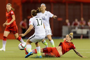 Anja Mittag #11 of Germany kicks the ball away from Tobin Heath #17 of the United States in the first half in the FIFA Women's World Cup 2015 Semi-Final Match at Olympic Stadium on June 30, 2015 in Montreal, Canada.