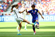 Aya Miyama #8 of Japan with the ball against Tobin Heath #17 of the United States in the first half in the FIFA Women's World Cup Canada 2015 Final at BC Place Stadium on July 5, 2015 in Vancouver, Canada.