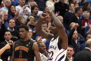 Josh Selby #32 of the Kansas Jayhawks reacts after scoring a three pointer to put the Jayhawks up for good as Alex Stepheson #1 of the USC Trojans looks on during the game on December 18, 2010 at Allen Fieldhouse in Lawrence, Kansas.  The Jayhawks defeated the Trojans with a final score of 70-68.