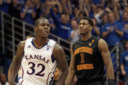 Josh Selby #32 of the Kansas Jayhawks reacts after scoring as Alex Stepheson #1 of the USC Trojans looks on during the game on December 18, 2010 at Allen Fieldhouse in Lawrence, Kansas.
