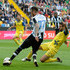 Duvan Zapata Photos - Cyril Thereau (L)  of Udinese Calcio competes with Alessandro Gamberini of Chievo Verona  during the Serie A match between Udinese Calcio and AC Chievo Verona at Stadio Friuli on April 17, 2016 in Udine, Italy. - Udinese Calcio v AC Chievo Verona - Serie A