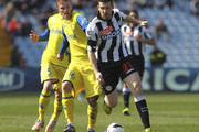 Andrea Lazzari (R) of Udinese Calcio competes for the ball with Luca Rigoni (L) of AC Chievo Verona during the Serie A match between Udinese Calcio and AC Chievo Verona at Stadio Friuli on April 7, 2013 in Udine, Italy.