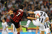 Pato (L) of AC Milan competes in the air with Aleksandar Lukovic of Udinese Calcio during the Serie A match between Udinese Calcio and AC Milan at Stadio Friuli on September 23, 2009 in Udine, Italy.