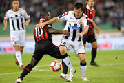 (R to L) Aleksandar Lukovic of Udinese Calcio competes with Clarence Seedorf of AC Milan during the serie A match between Udinese Calcio and AC Milan at Stadio Friuli on September 23, 2009 in Udine, Italy.