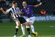 Andrea Lazzari (L) of Udinese Calcio competes with Borja Valero of ACF Fiorentina during the Serie A match between Udinese Calcio and ACF Fiorentina at Stadio Friuli on November 24, 2013 in Udine, Italy.
