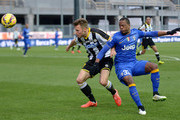 Silvan Widmer  (L) of Udinese Calcio competes with Patrice Evra of Juventus FC during the Serie A match between Udinese Calcio and Juventus FC at Stadio Friuli on February 1, 2015 in Udine, Italy.