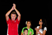 Ufuk Talay of the Ufuk Talay XI team acknowledges the crowd with his family after being presented with a signed shirt at the end  of the charity football match between Ufuk Talay XI and the All Stars at Tony Ireland Stadium on February 16, 2011 in Townsville, Australia.