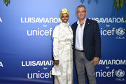 Halima Aden and Paolo Rozera attend the photocall at the Unicef Summer Gala Presented by Luisaviaroma at  on August 09, 2019 in Porto Cervo, Italy.
