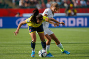 Orianica Velasquez #9 of Colombia controls the ball against Tobin Heath #17 of the United States in the FIFA Women's World Cup 2015 Round of 16 match at Commonwealth Stadium on June 22, 2015 in Edmonton, Canada.