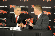 Athletic Director Kevin Anderson (L) of the University of Maryland introduces Randy Edsall as its new head football coach on January 3, 2011 at the Byrd Stadium in College Park, Maryland.