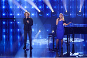 """Host Barbara Schoeneberger (R) and singer Michael Schulte perform live on stage during the show """"Unser Lied fuer Israel"""" at Studio Berlin Adlershof on February 22, 2019 in Berlin, Germany. The winner will represent Germany at the Eurovision Song Contest in Tel Aviv, Israel in May 2019."""