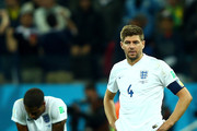 Glen Johnson  (L) and Steven Gerrard of England look dejected after a 2-1 defeat in the 2014 FIFA World Cup Brazil Group D match between Uruguay and England at Arena de Sao Paulo on June 19, 2014 in Sao Paulo, Brazil.