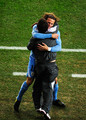 Diego Forlan of Uruguay celebrates scoring his second goal with a member of the coaching staff during the 2010 FIFA World Cup South Africa Third Place Play-off match between Uruguay and Germany at The Nelson Mandela Bay Stadium on July 10, 2010 in Port Elizabeth, South Africa.