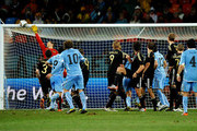 Diego Forlan of Uruguay shoots a free kick in the dying seconds of the match during the 2010 FIFA World Cup South Africa Third Place Play-off match between Uruguay and Germany at The Nelson Mandela Bay Stadium on July 10, 2010 in Port Elizabeth, South Africa.
