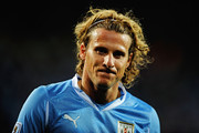 Diego Forlan of Uruguay looks on during the 2010 FIFA World Cup South Africa Third Place Play-off match between Uruguay and Germany at The Nelson Mandela Bay Stadium on July 10, 2010 in Port Elizabeth, South Africa.