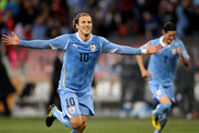 Diego Forlan of Uruguay celebrates scoring his team's second goal during the 2010 FIFA World Cup South Africa Third Place Play-off match between Uruguay and Germany at The Nelson Mandela Bay Stadium on July 10, 2010 in Port Elizabeth, South Africa.