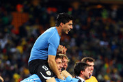 Luis Suarez and Sebastian Eguren of Uruguay celebrate victory after winning a penalty shoot out during the 2010 FIFA World Cup South Africa Quarter Final match between Uruguay and Ghana at the Soccer City stadium on July 2, 2010 in Johannesburg, South Africa.