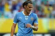 Diego Forlan of Uruguay reacts after missing a penalty during a shootout during the FIFA Confederations Cup Brazil 2013 3rd Place match between Uruguay and Italy at Estadio Octavio Mangabeira (Arena Fonte Nova Salvador) on June 30, 2013 in Salvador, Brazil.