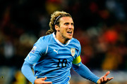 Diego Forlan of Uruguay celebrates scoring his team's first goal during the 2010 FIFA World Cup South Africa Semi Final match between Uruguay and the Netherlands at Green Point Stadium on July 6, 2010 in Cape Town, South Africa.