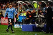 Dejected Diego Forlan of Uruguay after being substituted during the 2010 FIFA World Cup South Africa Semi Final match between Uruguay and the Netherlands at Green Point Stadium on July 6, 2010 in Cape Town, South Africa.