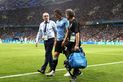 Edinson Cavani of Uruguay receives medical treatment during the 2018 FIFA World Cup Russia Round of 16 match between Uruguay and Portugal at Fisht Stadium on June 30, 2018 in Sochi, Russia.
