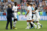 Luis Suarez of Uruguay argues with Paul Pogba of France during the 2018 FIFA World Cup Russia Quarter Final match between Uruguay and France at Nizhny Novgorod Stadium on July 6, 2018 in Nizhny Novgorod, Russia.