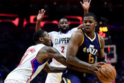 Joe Johnson #6 of the Utah Jazz looks for a shot as he is guarded by Jamal Crawford #11 and Raymond Felton #2 of the LA Clippers during a 97-95 Jazz win at Staples Center on April 15, 2017 in Los Angeles, California.  NOTE TO USER: User expressly acknowledges and agrees that, by downloading and or using this photograph, User is consenting to the terms and conditions of the Getty Images License Agreement.