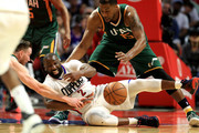 Gordon Hayward #20 and Derrick Favors #15 of the Utah Jazz battle Raymond Felton #2 of the Los Angeles Clippers for a loose ball during the second half of Game Seven of the Western Conference Quarterfinals at Staples Center at Staples Center on April 30, 2017 in Los Angeles, California.  NOTE TO USER: User expressly acknowledges and agrees that, by downloading and or using this photograph, User is consenting to the terms and conditions of the Getty Images License Agreement.
