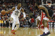 Donovan Mitchell #45 of the Utah Jazz dribbles the ball defended by James Harden #13 of the Houston Rockets in the first half at Toyota Center on October 24, 2018 in Houston, Texas.  NOTE TO USER: User expressly acknowledges and agrees that, by downloading and or using this Photograph, user is consenting to the terms and conditions of the Getty Images License Agreement.