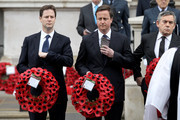 (L-R)  Liberal Democrats leader Nick Clegg, Conservative party leader David Cameron and Labour party leader Prime Minister Gordon Brown carry poppy wreathes as attend the VE Day 65th anniversary tributes at the Cenotaph in Whitehall on May 8, 2010 in London, England. The ceremony commerates Victory in Europe day, declared on 8 May 1945.