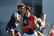 Jake Long of Essendon runs with the ball  during the round eight VFL match between the Northern Blues and Essendon at Ikon Park on May 26, 2018 in Melbourne, Australia.
