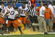 Head coach Mike Gundy of the Oklahoma State Cowboys escapes the gatorade bath from Jordan Sterns #13 of the Oklahoma State Cowboys in the Valero Alamo Bowl at the Alamodome on December 29, 2016 in San Antonio, Texas.