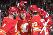The Calgary Flames celebrate after Elias Lindholm #28 scored their first goal against the Vancouver Canucks during an NHL game at Scotiabank Saddledome on October 6, 2018 in Calgary, Alberta, Canada.