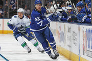 Tyler Bozak #42 of the Toronto Maple Leafs clears a puck in against the Vancouver Canucks during an NHL game at the Air Canada Centre on January 6, 2018 in Toronto, Ontario, Canada. The Maple Leafs defeated the Canucks 3-2 in an overtime shoot-out.