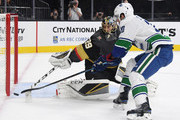 Marc-Andre Fleury #29 of the Vegas Golden Knights knocks the puck away from Brandon Sutter #20 of the Vancouver Canucks in the first period of their game at T-Mobile Arena on October 24, 2018 in Las Vegas, Nevada. The Canucks defeated the Golden Knights 3-2 in a shootout.