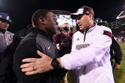 Head coach Dan Mullen of the Mississippi State Bulldogs and head coach Derek Mason of the Vanderbilt Commodores meet at midfield following a game at Davis Wade Stadium on November 22, 2014 in Starkville, Mississippi.  Mississippi State won the game 51-0.