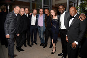 (L-R) Producer Brad Simpson, writer/producer/director Ryan Murphy, actor John Travolta, CEO, FX Networks, John Landgraf, producer D.V. DeVincentis, actor Cuba Gooding Jr., producer Nina Jacobson, actor Sterling K. Brown and director John Singleton at Vanity Fair And FX's Annual Primetime Emmy Nominations Party on September 17, 2016 in Beverly Hills, California.
