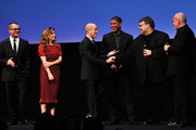 Executive producer Guillermo del Toro (second right) shakes hands with Jeffrey Katzenberg onstage ahead of director Peter Ramsey collecting the Vanity Fair International Award for Cinematic Excellence for the film 'Rise of the Guardians' as (L-R) Pappi Corsicato, producer Christina Steinberg and festival director Marco Mueller (R)  look on during a presentation at the 7th Rome Film Festival on November 13, 2012 in Rome, Italy.
