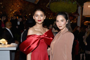 Zendaya (L), Olivia Munn, Vanity Fair x Lancôme Paris With Belvedere Vodka Raise A Glass To Toast Women In Hollywood on February 21, 2019 in Los Angeles, California.