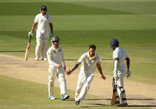 Australia v India - 1st Test: Day 5 [test cricket,cricket,sports,cricketer,bat-and-ball games,sport venue,first-class cricket,sports equipment,team sport,player,mitchell johnson,varun aaron,wicket,australia,india,adelaide oval,test,test match]