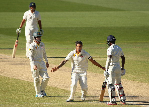 Australia v India - 1st Test: Day 5 [cricket,test cricket,cricketer,sports,bat-and-ball games,first-class cricket,cricket bat,sports equipment,team sport,player,mitchell johnson,varun aaron,wicket,australia,india,adelaide oval,test,test match]