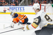 Goaltender Cam Talbot #33 of the Edmonton Oilers makes a save against Tomas Tatar #90 of the Vegas Golden Knights at Rogers Place on April 5, 2018 in Edmonton, Canada.