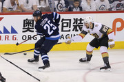 Paul Stastny #25 of the Winnipeg Jets is pursued by Shea Theodore #27 of the Vegas Golden Knights in Game One of the Western Conference Finals during the 2018 NHL Stanley Cup Playoffs at Bell MTS Place on May 12, 2018 in Winnipeg, Canada.