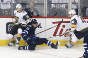 Paul Stastny #25 of the Winnipeg Jets battles for the puck with Cody Eakin #21 and Ryan Carpenter #40 of the Vegas Golden Knights during the first period in Game Five of the Western Conference Finals during the 2018 NHL Stanley Cup Playoffs at Bell MTS Place on May 20, 2018 in Winnipeg, Canada.