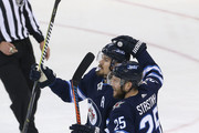 Paul Stastny #25 of the Winnipeg Jets congratulates teammate Mark Scheifele #55 on his second period goal against the Vegas Golden Knights in Game One of the Western Conference Finals during the 2018 NHL Stanley Cup Playoffs on May 12, 2018 at Bell MTS Place in Winnipeg, Manitoba, Canada. (Photo by Jason Halstead /Getty Images) *** Local Caption *** Paul Stastny; Mark Scheifele